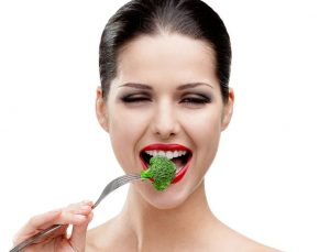 bigstock-Woman-with-red-lipstick-eating-43223464.2